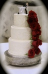 White Wedding Cake with Fresh Red Roses